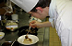 Plating up in the kitchens at Westminster Kingsway