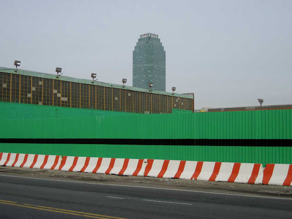 Gone Green - Fence & barrier next to Hunters Point Steel on 49th Ave. in Queens.