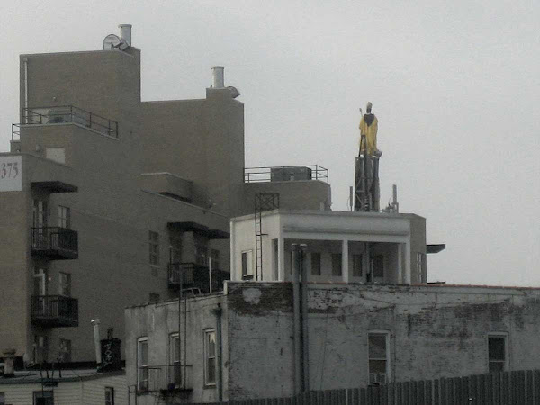Elevated Saint - San Paolino di Nola gazes at the backside of new condos from the 2010 Williamsburg giglio.
