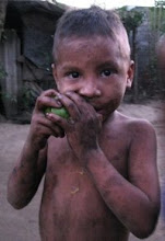 Boy eating mango in Nicaragua