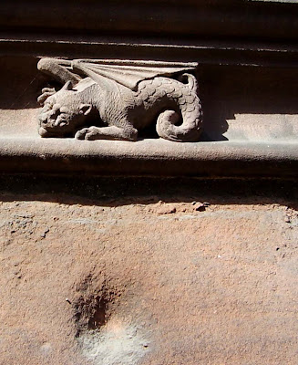 griffin outside the entrance to chester cathedral