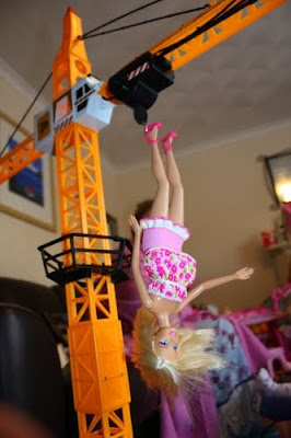 How creative can you get with a barbie doll and a crane?