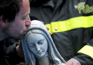 Fireman Kissing Head of Statue of the BVM