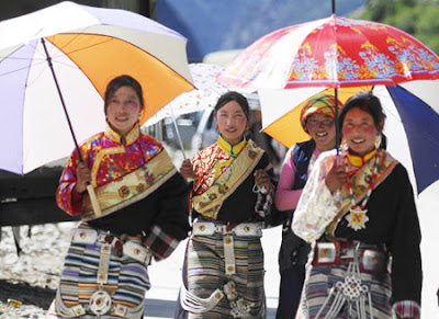 nyingchi girls China guide - jingting mountain  nyingchi, nagqu and other  walking passed a large office where a number of serious looking girls appeared to be under siege .