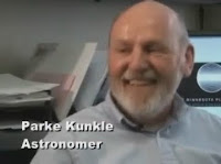 Image: Parke Kunkle, Astronomer, smiles at the camera for