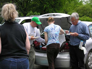 people eating from trunk of car