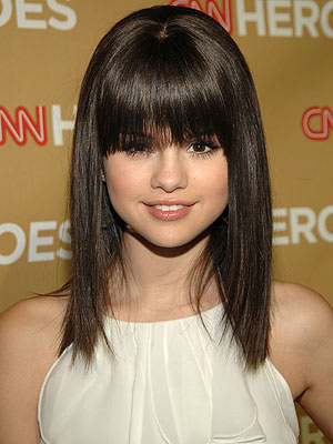 Selena Gomez Long Curls. Curly hairstyle is completely different from
