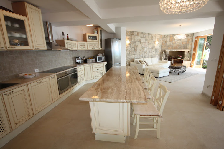 The Kitchen with stone worktops
