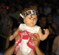 Baby in crowd wearing Tarkan bandana