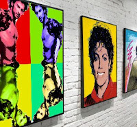Tarkan and Michael Jackson hanging on gallery wall