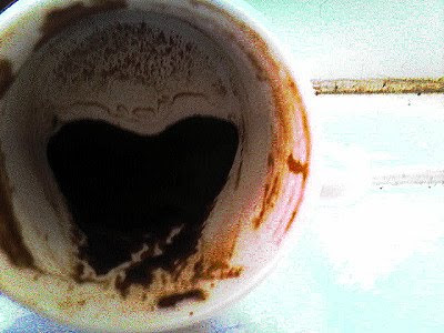 The sediment at the bottom of the Turkish coffee cup has shifted to one side of the cup, and lies in the shape of a large heart