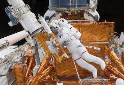 Mike Massimino repairing the Hubble Space Telescope