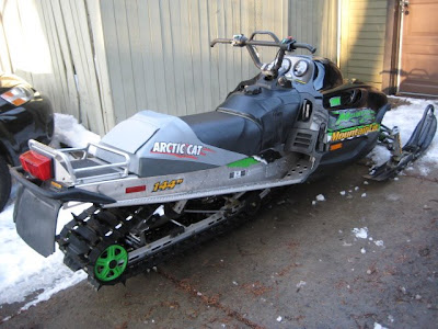 of the green Arctic Cat.