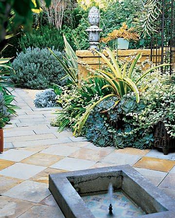 fuente tipo árabe jardín adoquinado