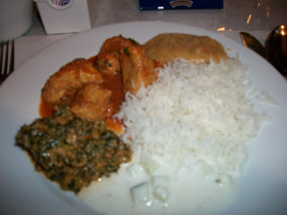 Click to enlarge - Curried chicken plated with basmati rice, saag aloo [spinach, potato and spices], and raita[yogurt - cucumber sauce].