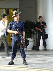 Gurkha troopers on guard at a carpark entrance of Raffles City during the 117th IOC Session. This file is licensed under the Creative Commons Attribution ShareAlike 2.5 License. In short: you are free to share and make derivative works of the file under the conditions that you appropriately attribute it, and that you distribute it only under a license identical to this one.