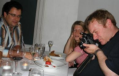 Howard doing what food bloggers do best
