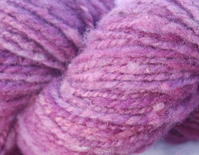 Close-up with rose-colored wool