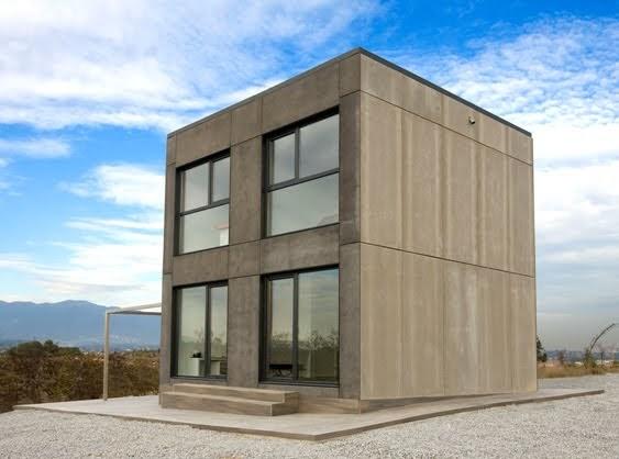 Casa minimalista y economica en forma de cubo fachadas for Construcciones minimalistas