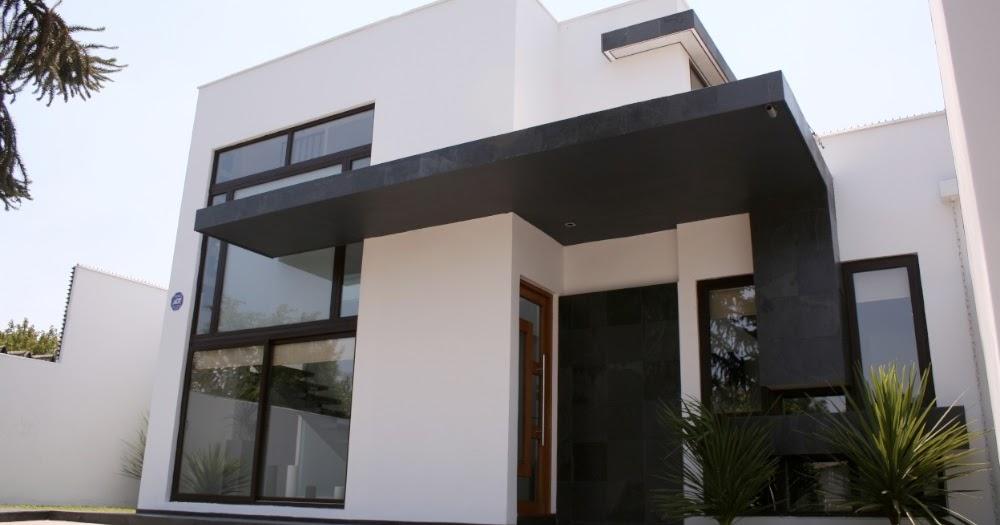 Fachada de casa de dos pisos en blanco y negro fachadas for Modelos de fachadas para casas de 2 pisos