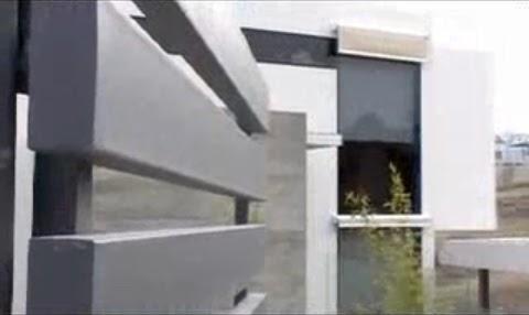 Fachada minimalista de hormigon fachadas de casas y for Fachadas edificios minimalistas