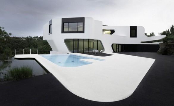 FACHADA DE CASA MINIMALISTA Casa Dupli por J. Mayer H. Arquitectos