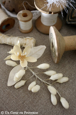 Small flowers of wax and fabric Communion