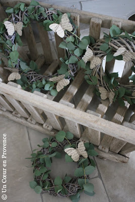 Some branches of eucalyptus are twisted around graying wreaths
