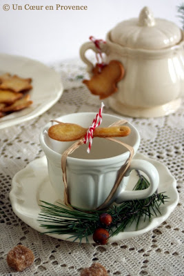 Teacup decorated with a spoon-shaped shortbread cookies for a festive time