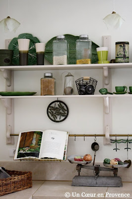 Kitchen shelves and open book Le Cahier de Recettes Provençales of Michel Biehn