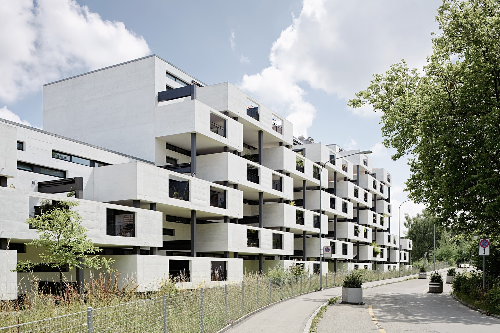 Arch plus 355 residential complex in the paul clairmont for Architects for residential homes