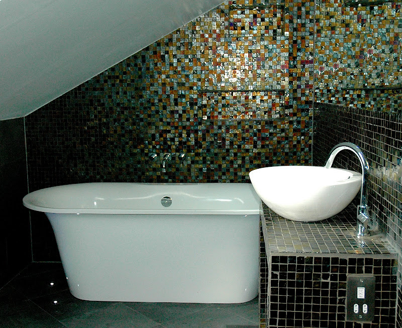 In a small attic bathroom a shower may fit where a bath would not title=