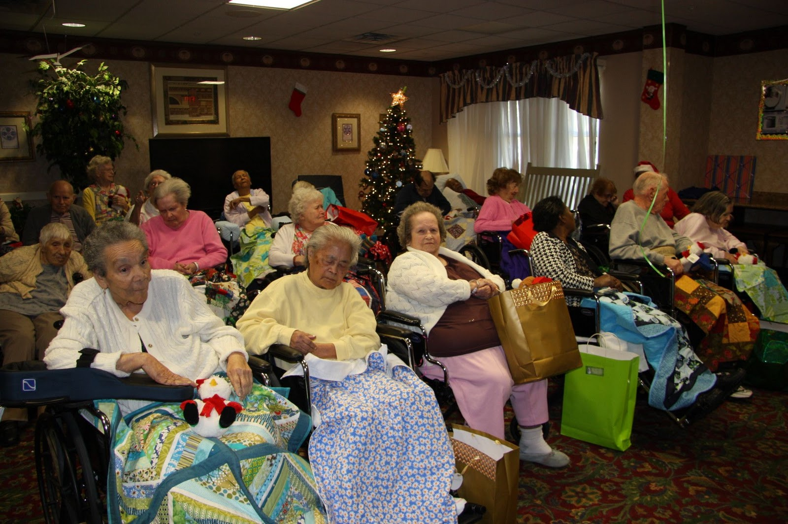 all the gifts were appreciated and the lap quilts in particular were a big hit with the residents what follows are pictures from the event many showing