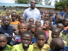 RWANDA: Lama Mugabo with Kazo elementary Students