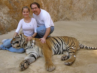 With a tiger and Amber in Thailand