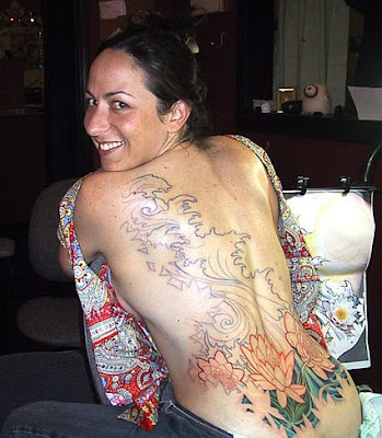 girls tattoos on back. Cute Girl and Flower Tattoo