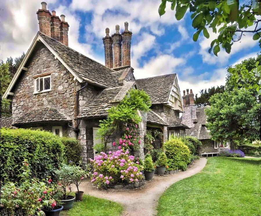 The stone cottage architecture featured here exudes loads for Cottage architecture
