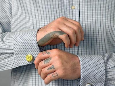Cute small symbol tattoos on fingers.