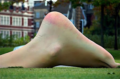 Giant swimmer sculpture in London