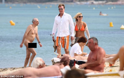 Look the other way: Geri turns away as a naked bather emerges from the