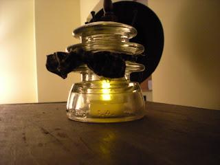 A great idea for tea-lites using insulators.