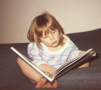 Erin, age 4, reading from an Eyewitness book