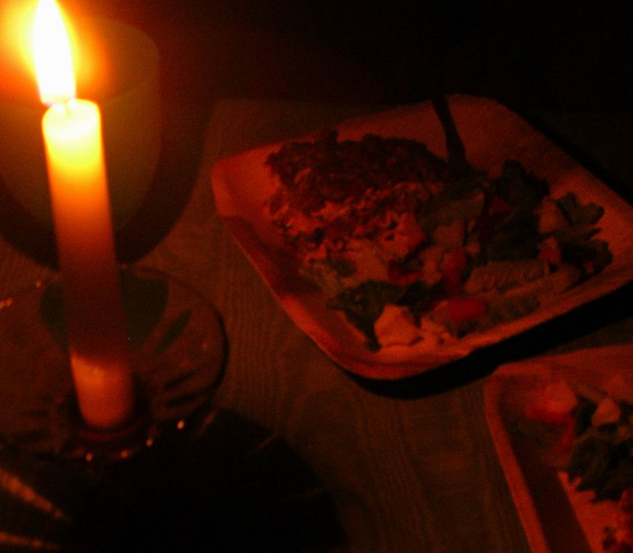 Sprigs of rosemary candlelight and my best lasagna made for Romantic dinner