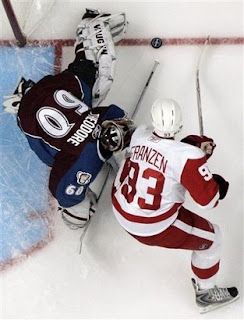 Colorado Avalanche goalie Jose Theodore blocks a shot by Detroit Red Wings center Johan Franzen, from Sweden, during Game 3 in the Western Conference semifinals hockey series in Denver, Tuesday, April 28, 2008. Detroit beat Colorado 4-3.<br />(AP Photo/Jack Dempsey)