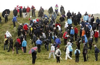 Phil Mickelson of the USA, center far left, and spectators look for his missing ball during the first round of the British Open Golf championship, at the Royal Birkdale golf course, Southport, England, Thursday, July 17, 2008. (AP Photo/Jon Super)