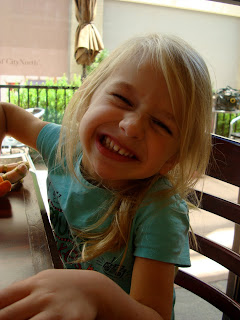 Child sitting at table smiling