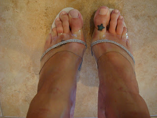Feet in high heeled shoes