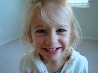 Close up of little girls face smiling