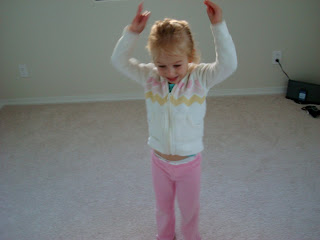 Young girl in room dancing