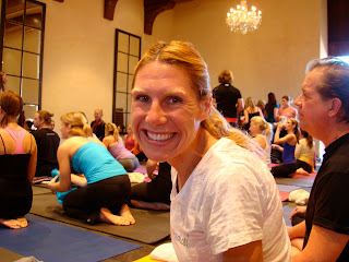 Woman smiling on yoga mat at Master Class